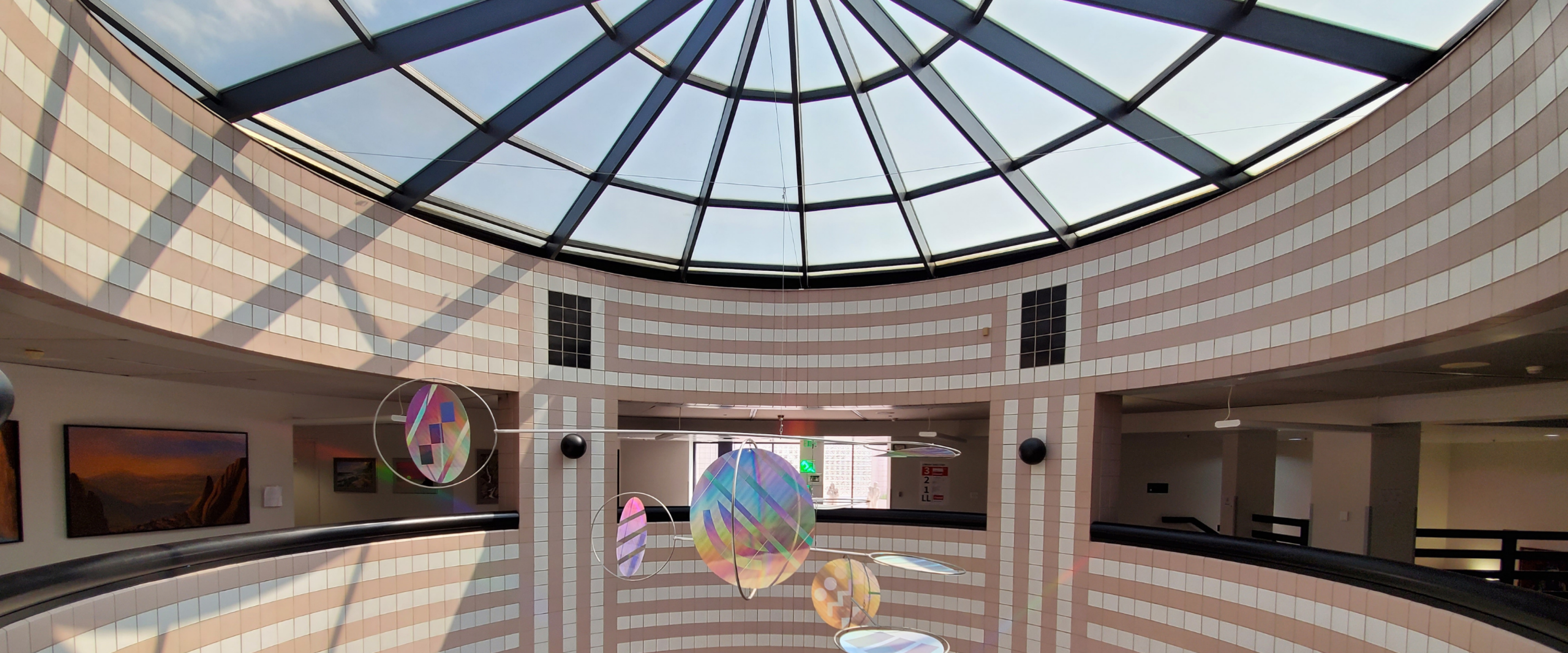 Look up through the round, glass atrium roof in Waldo Library.