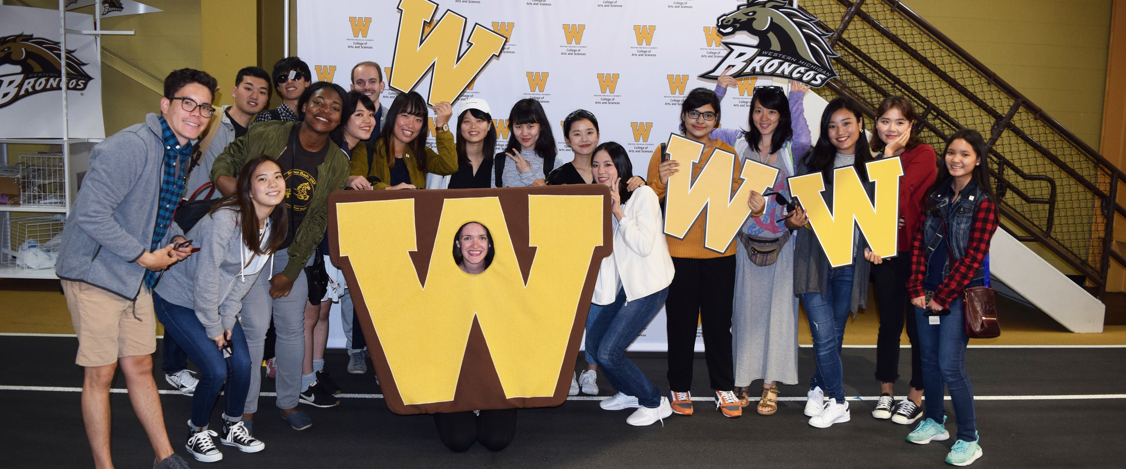 Group of students posing with props at Fall Welcome