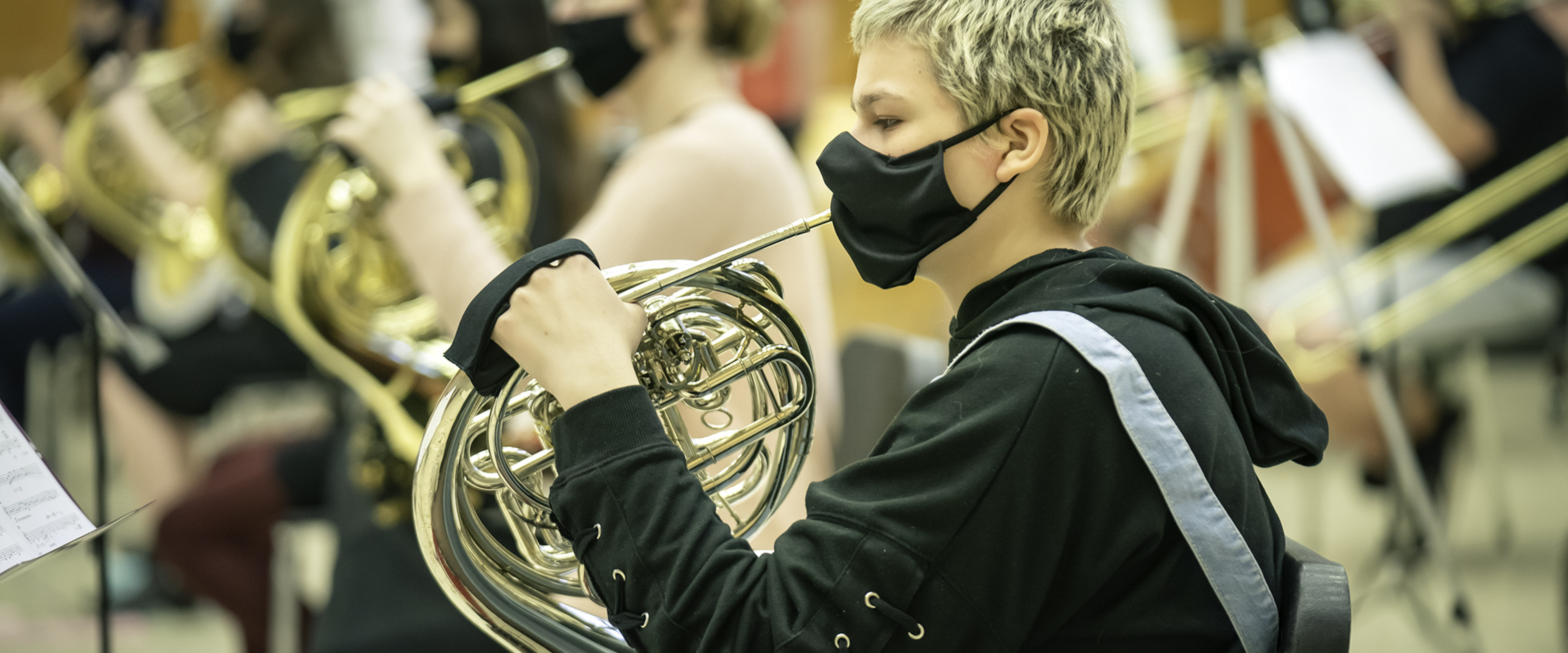 Horn students rehearsing in band.