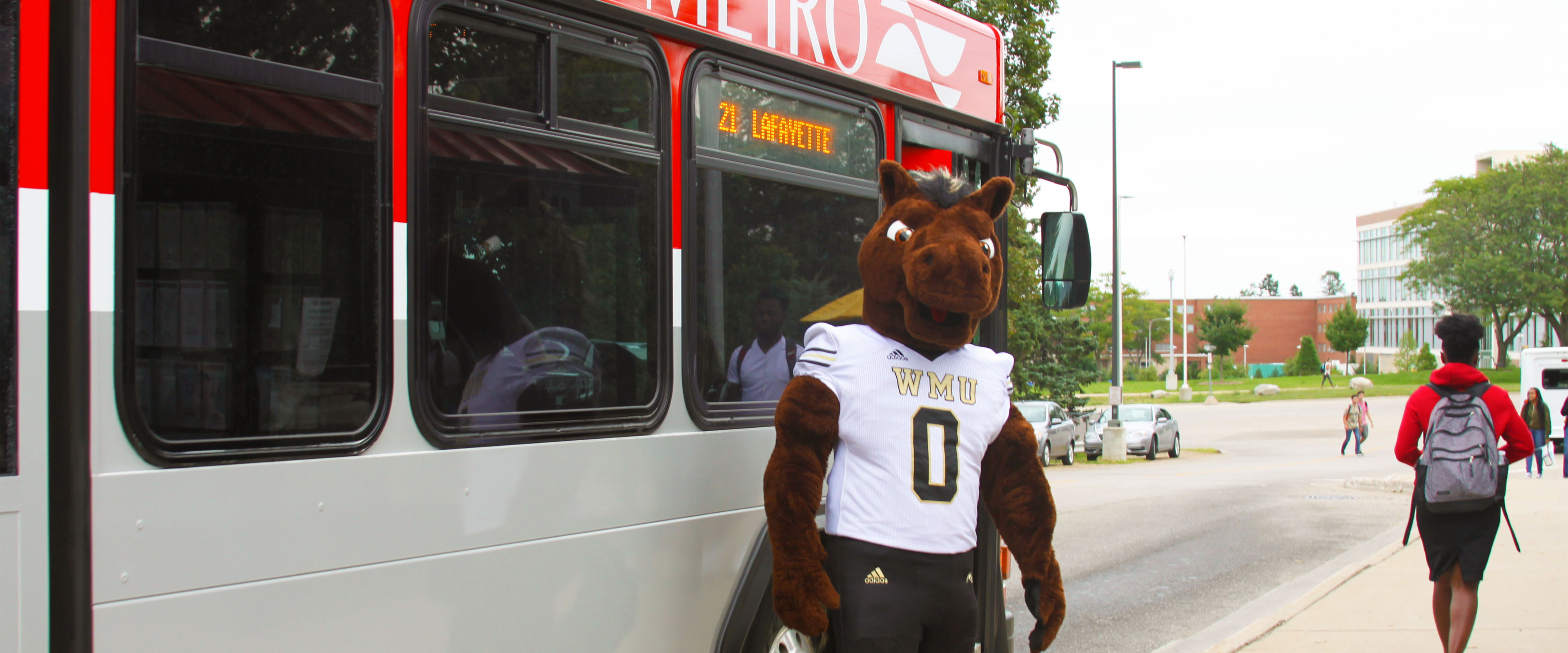 Buster in front of a Metro Transit bus