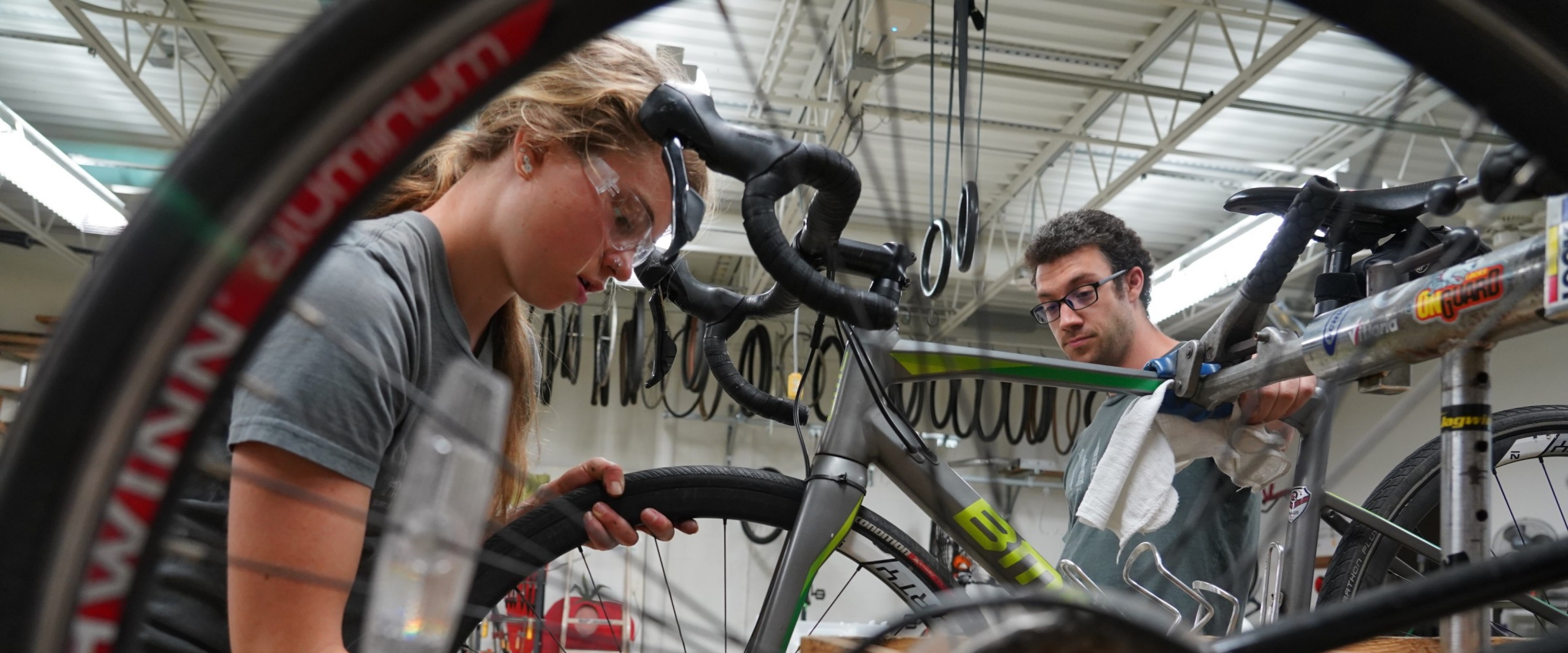 A pair of students work on a bicycle at WMU's Open Bike Shop