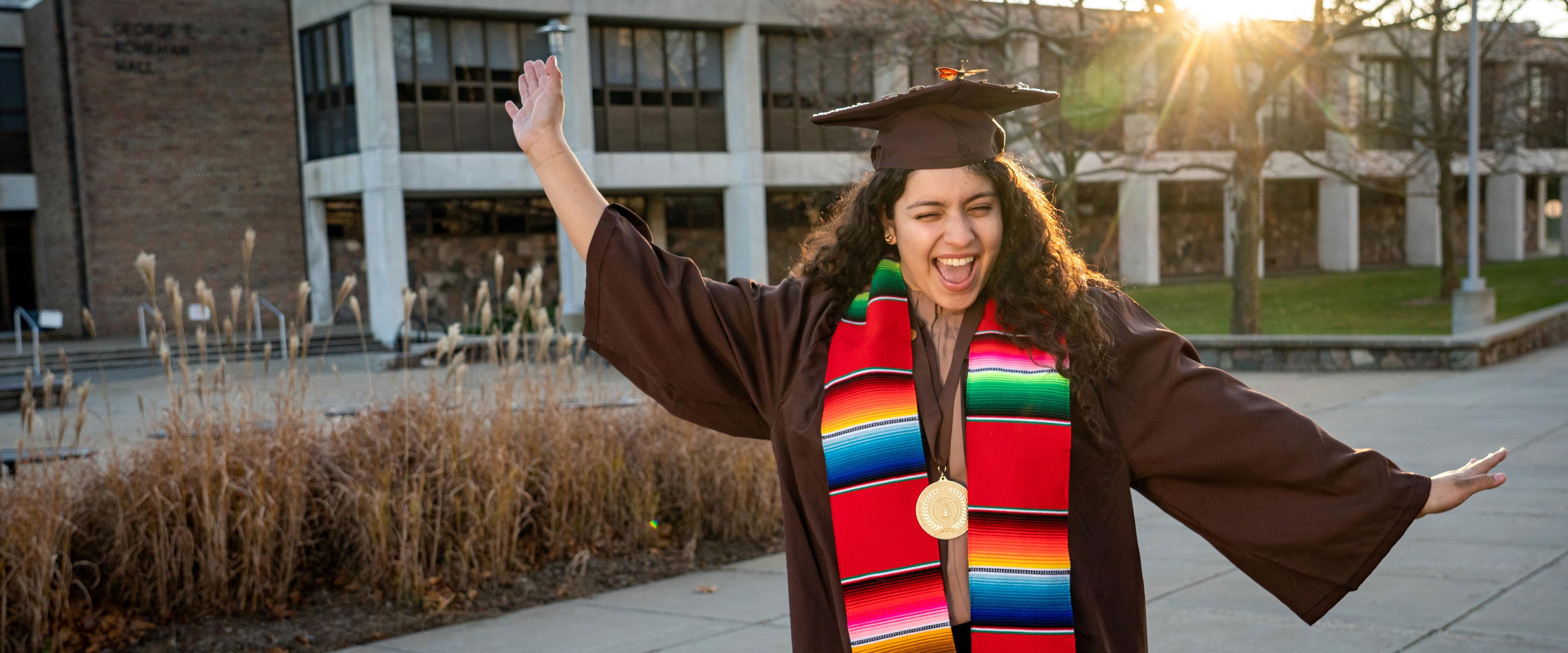 Valeria Marin celebrates graduating in her cap and gown.