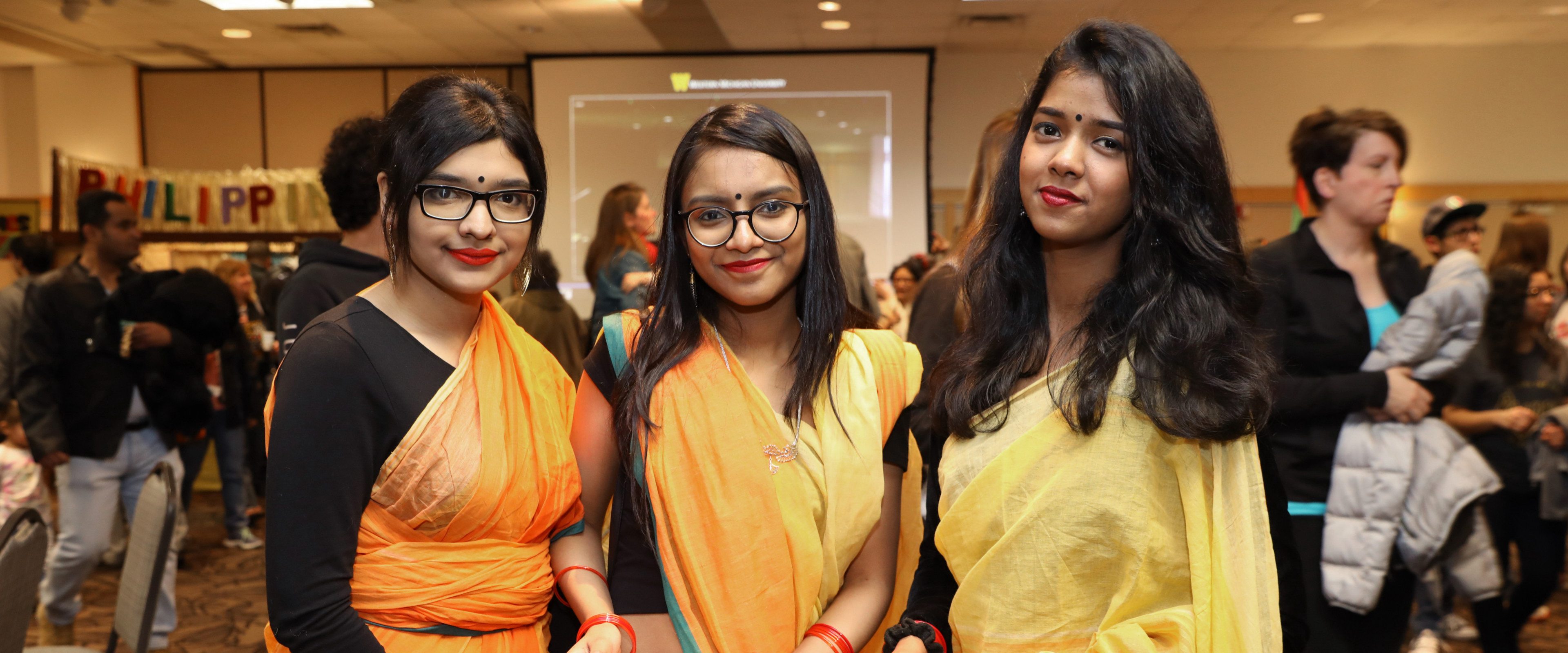Three students from the Bangladesh Student Association wear traditional outfits.