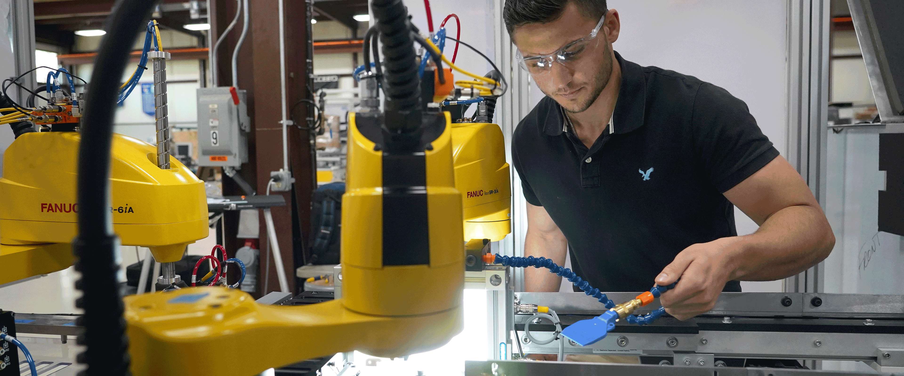 Page banner image: a student intern works with large technology machines