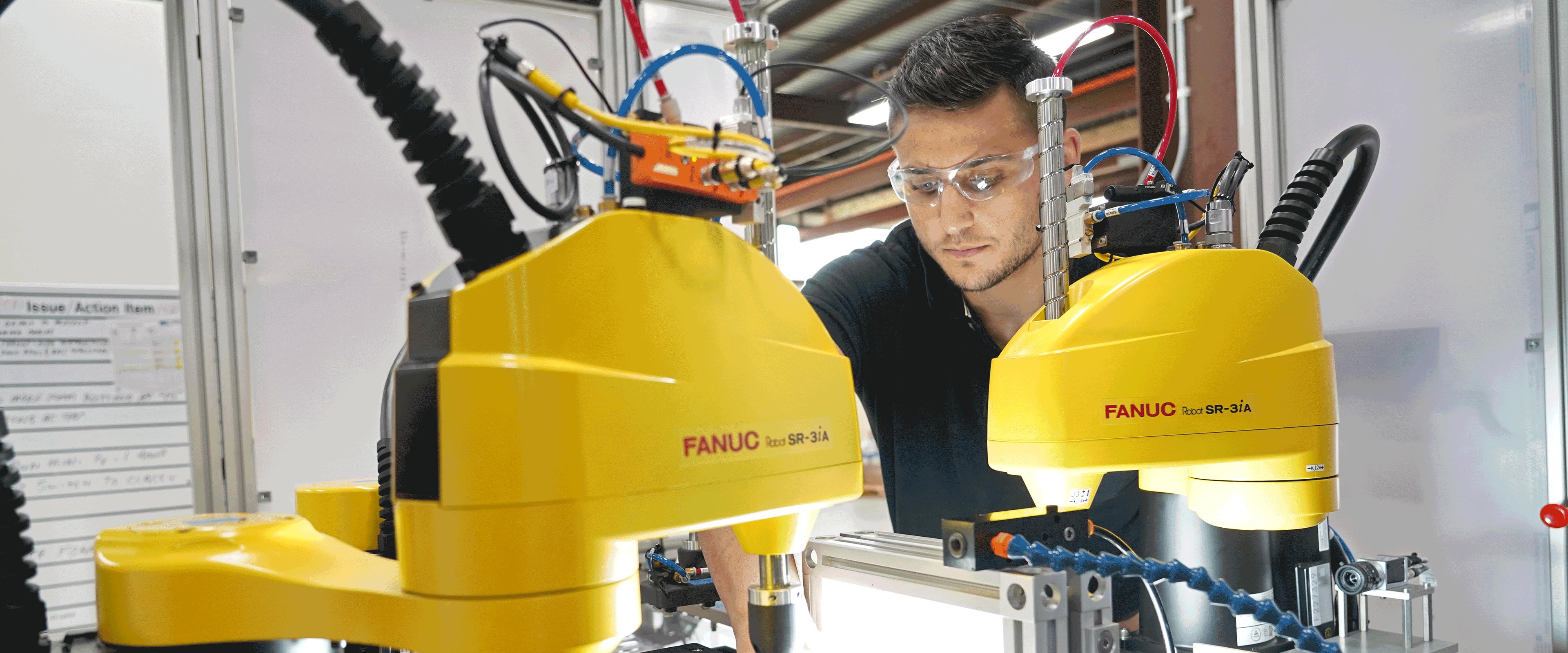Joseph Backe works with large technology machines