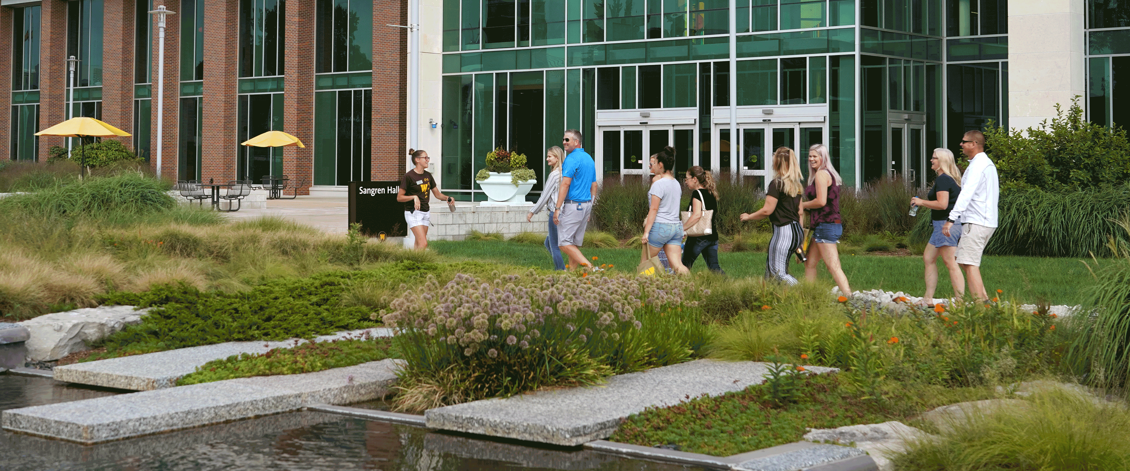 Page banner: students walking during a campus tour in front of Sangren Hall