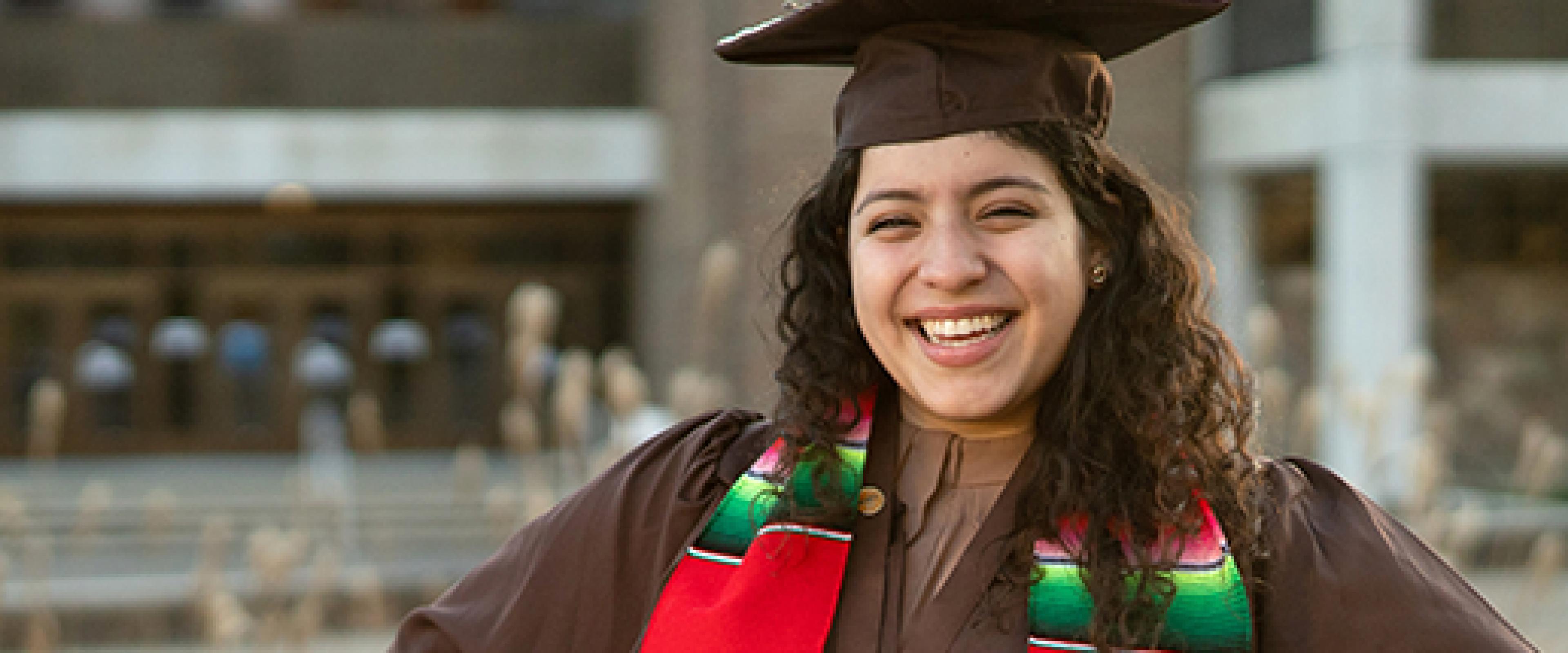 WMU Graduate posing for the camera