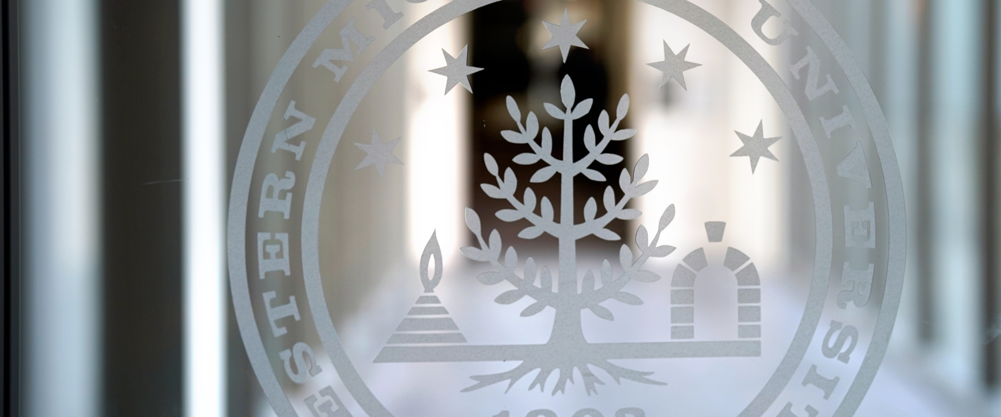 Page banner image: WMU Seal embossed on a glass window