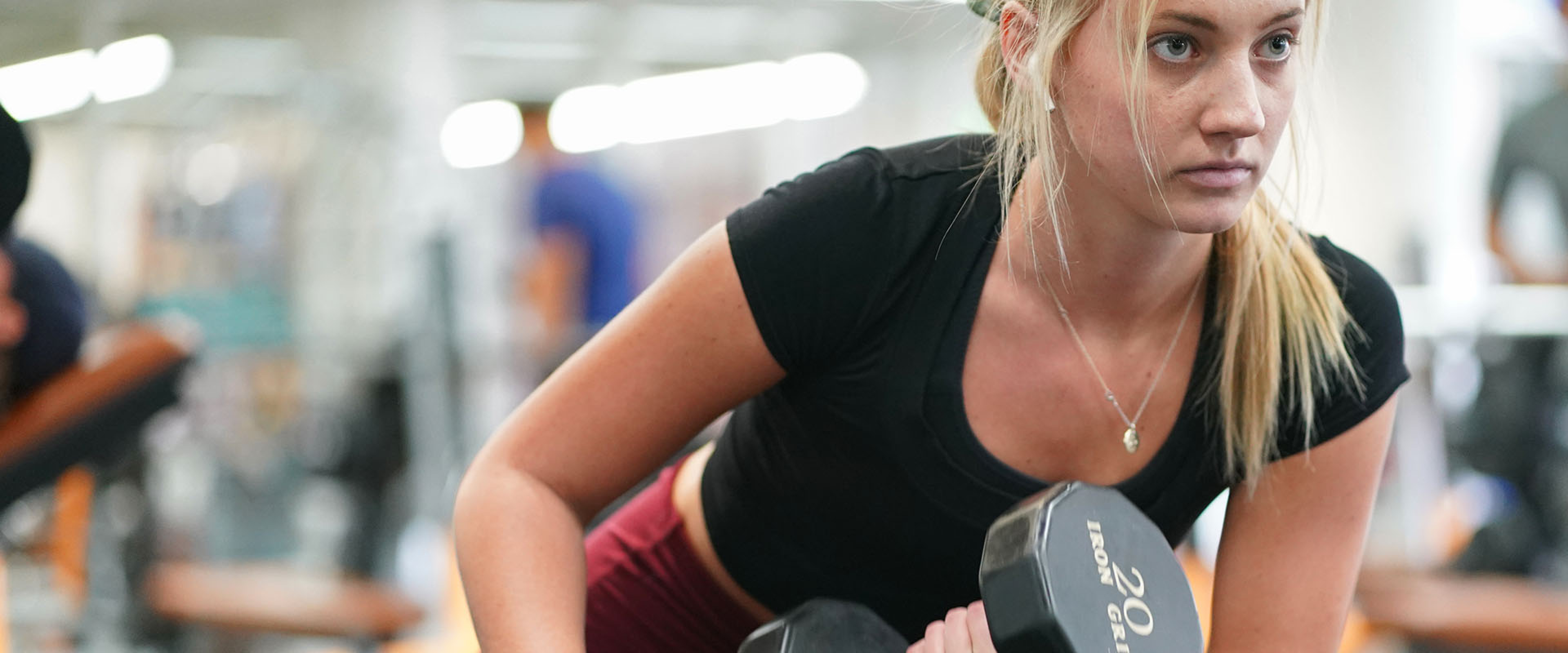 A WMU student lifting weights at the Student Rec Center