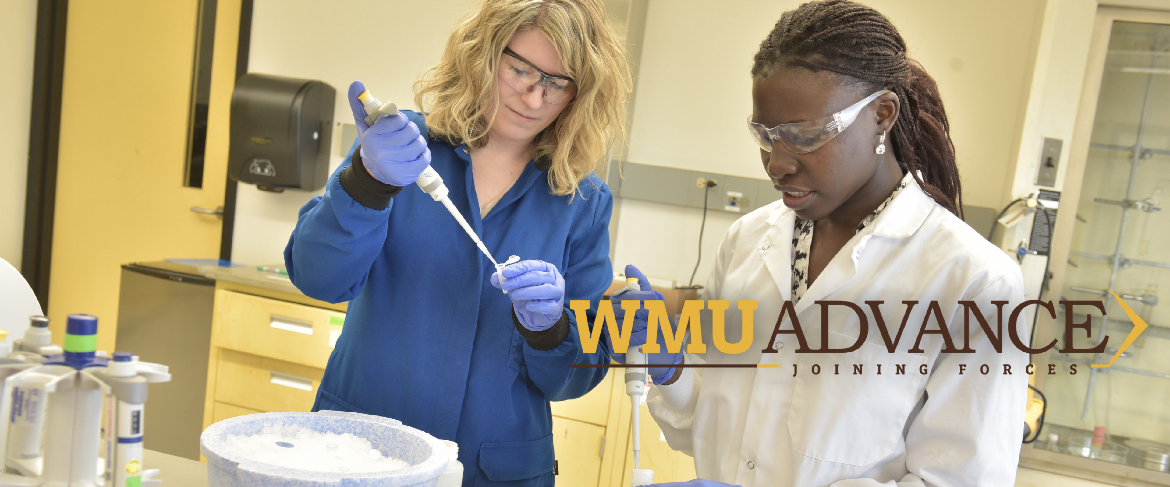 """""""WMU ADVANCE Joining Forces""""; professor and student working in lab"""