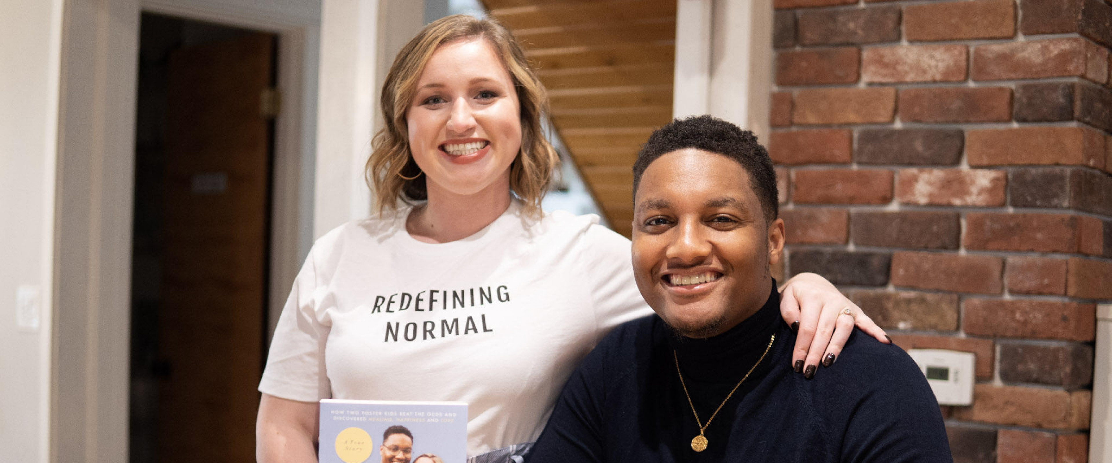 """Alexis and Justin Black pose by their new book, """"Redefining Normal"""""""