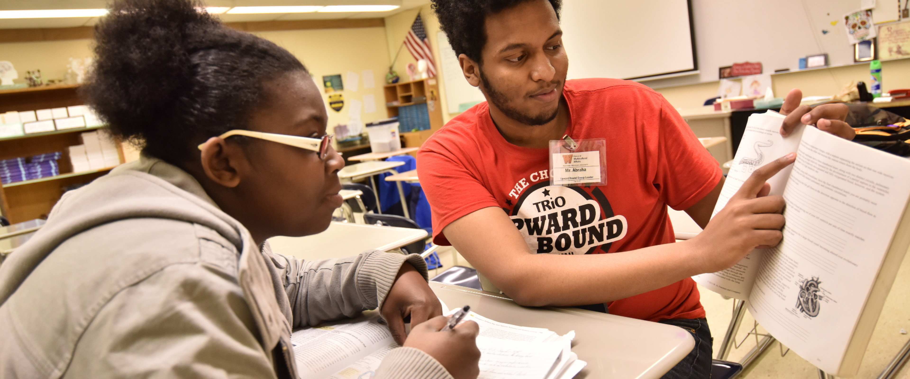 Upward Bound student being helped by a tutor.