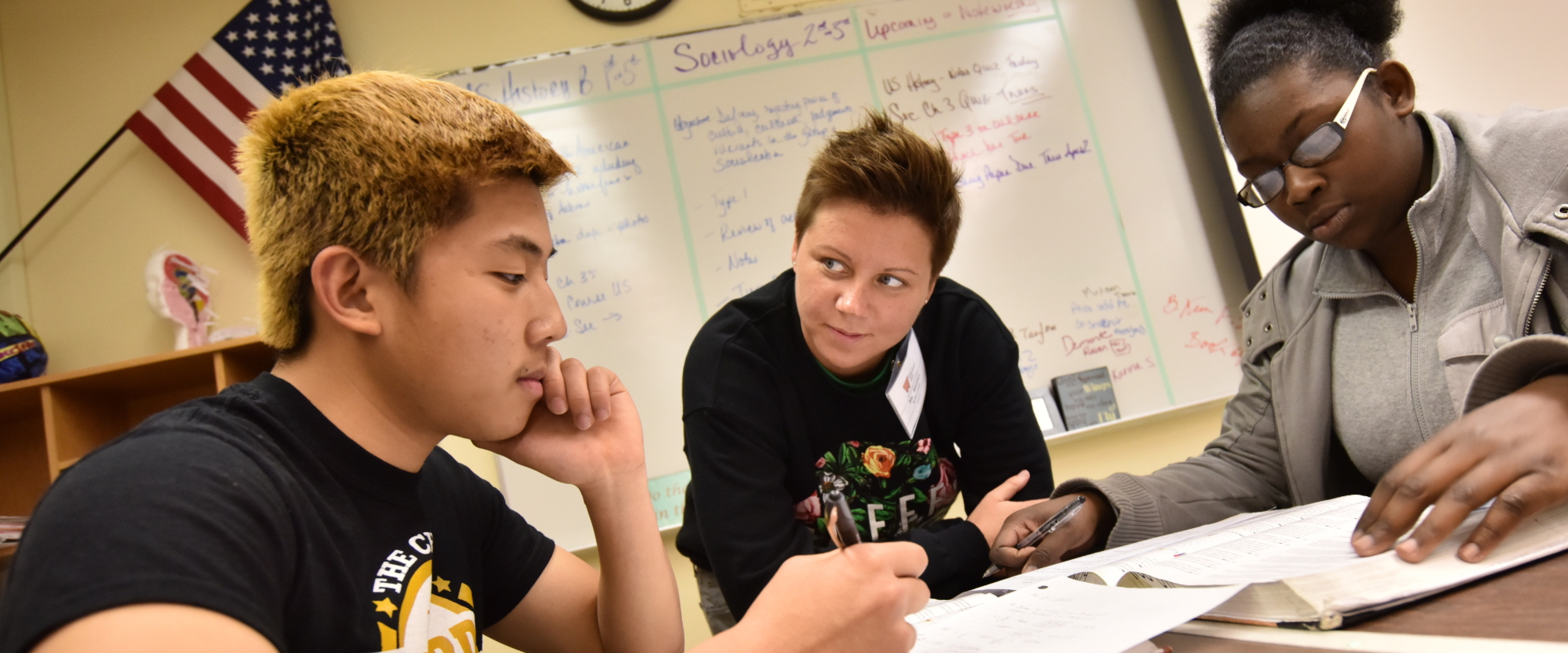 Upward Bound students being helped by a tutor.