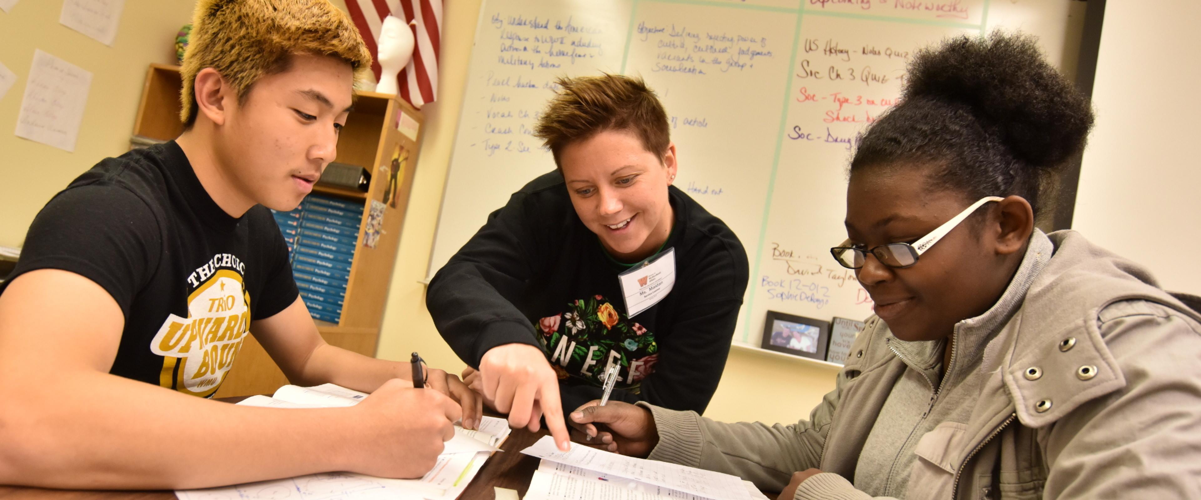 Two students being tutored through Upward Bound's tutoring program.