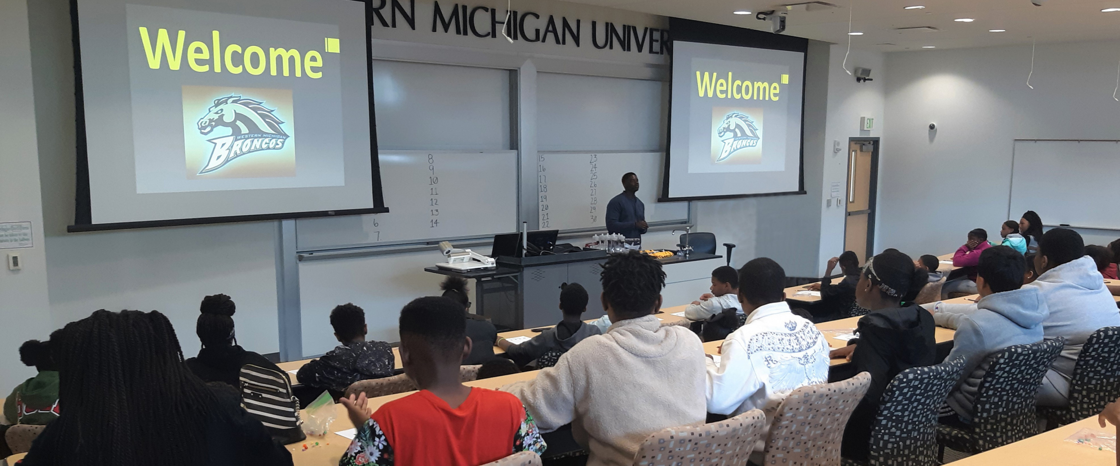 Students watching a WMU admissions presentation