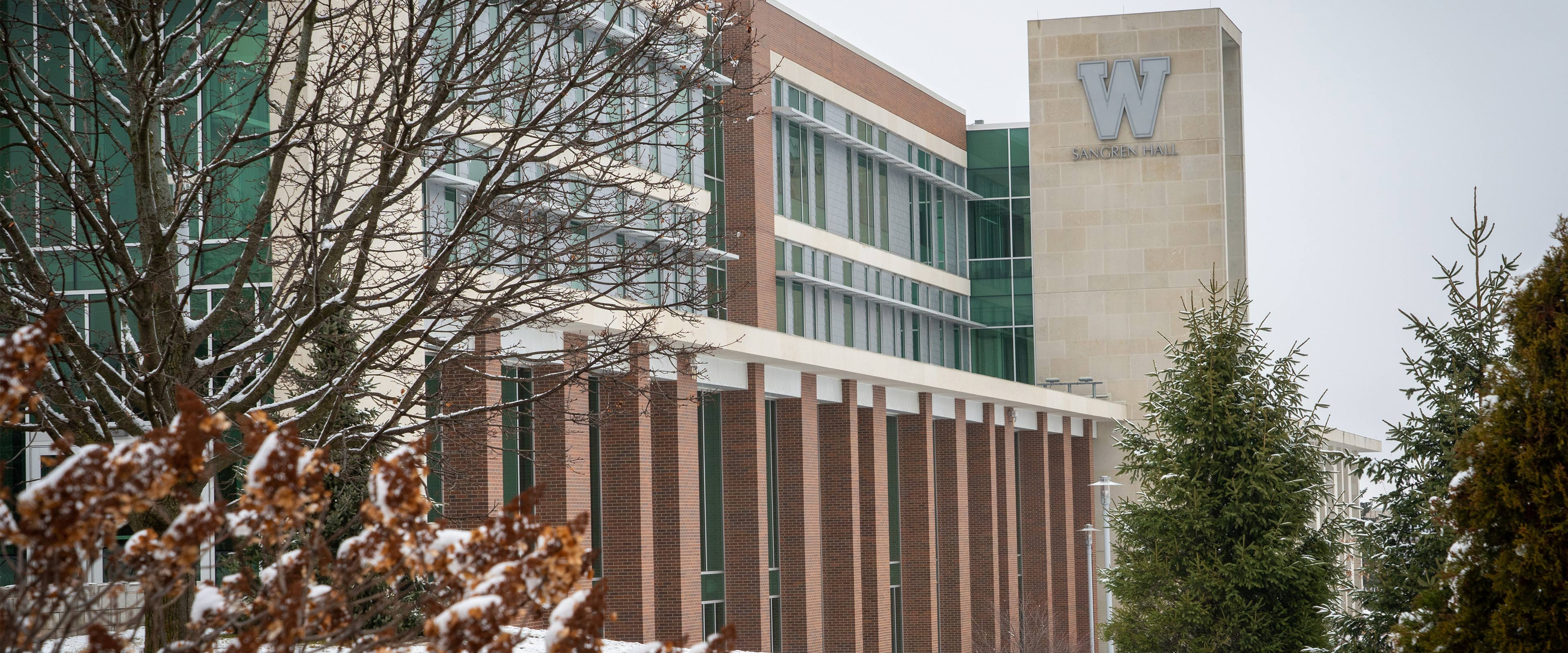 A snowy scene in front of Sangren Hall.