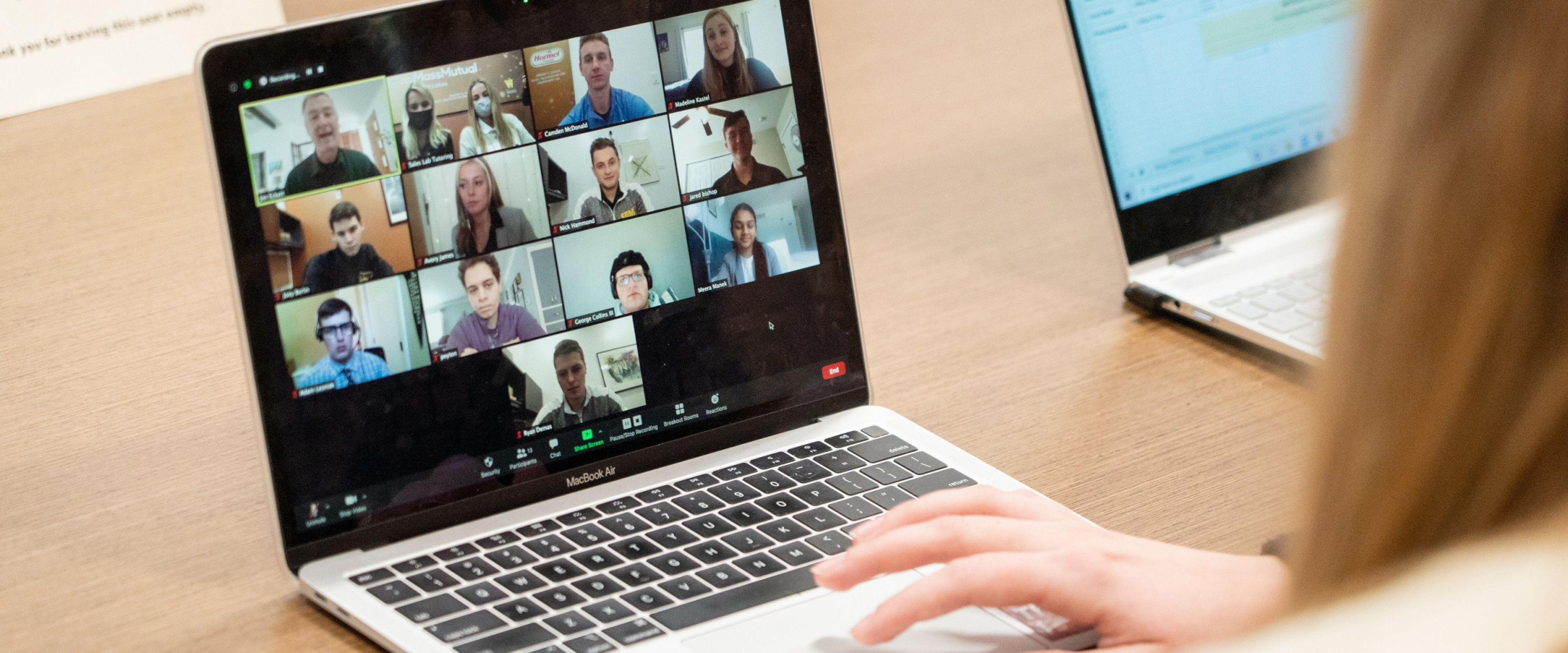 Woman is participating in a virtual meeting on her laptop