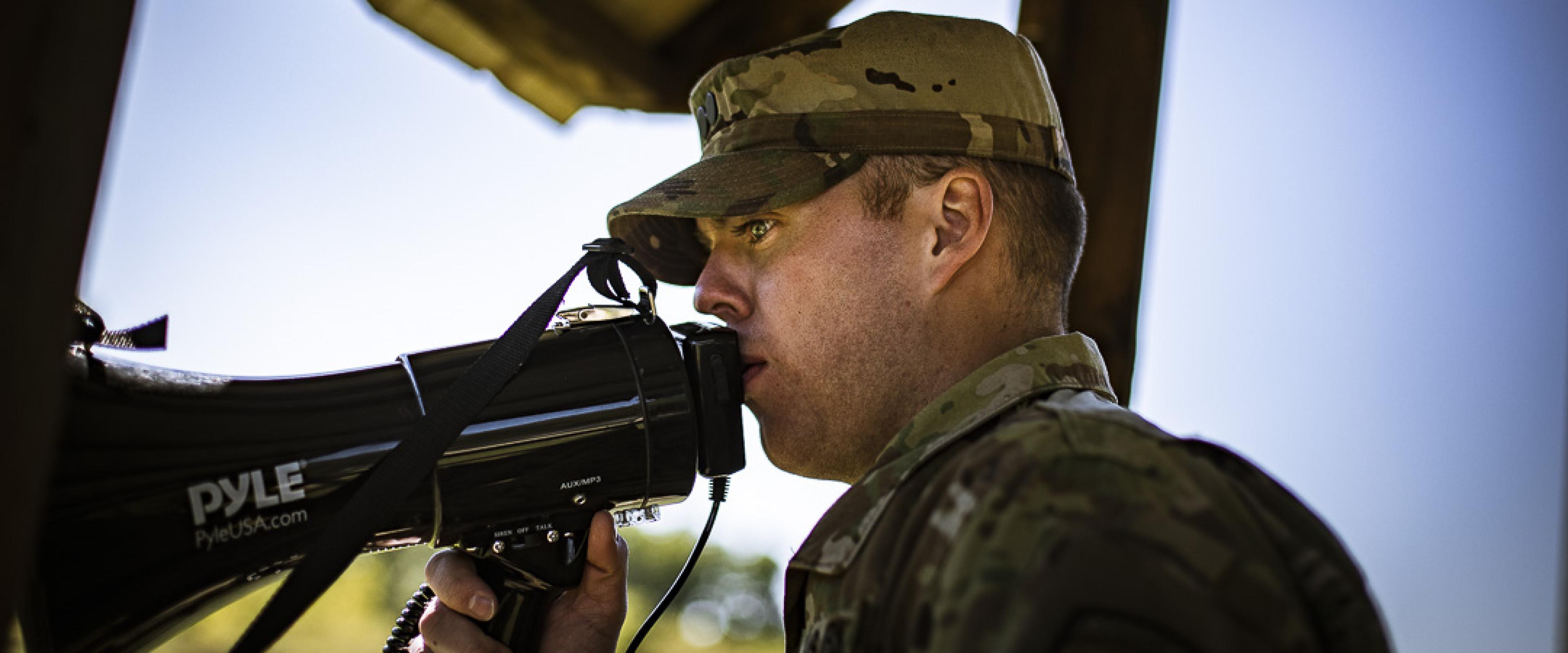 Cadet speaking through a megaphone