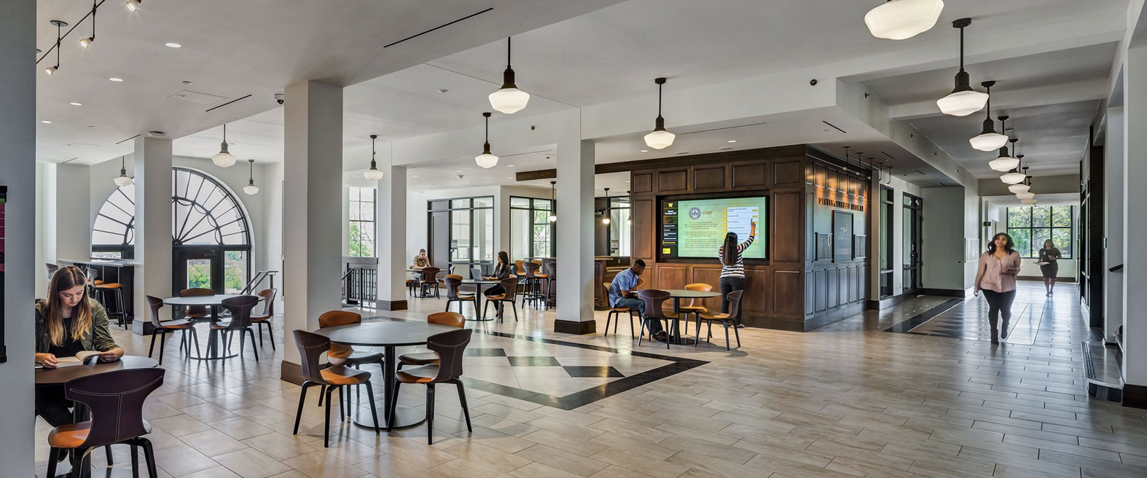 Interior of Heritage Hall lobby showing large open space and hardwood floors