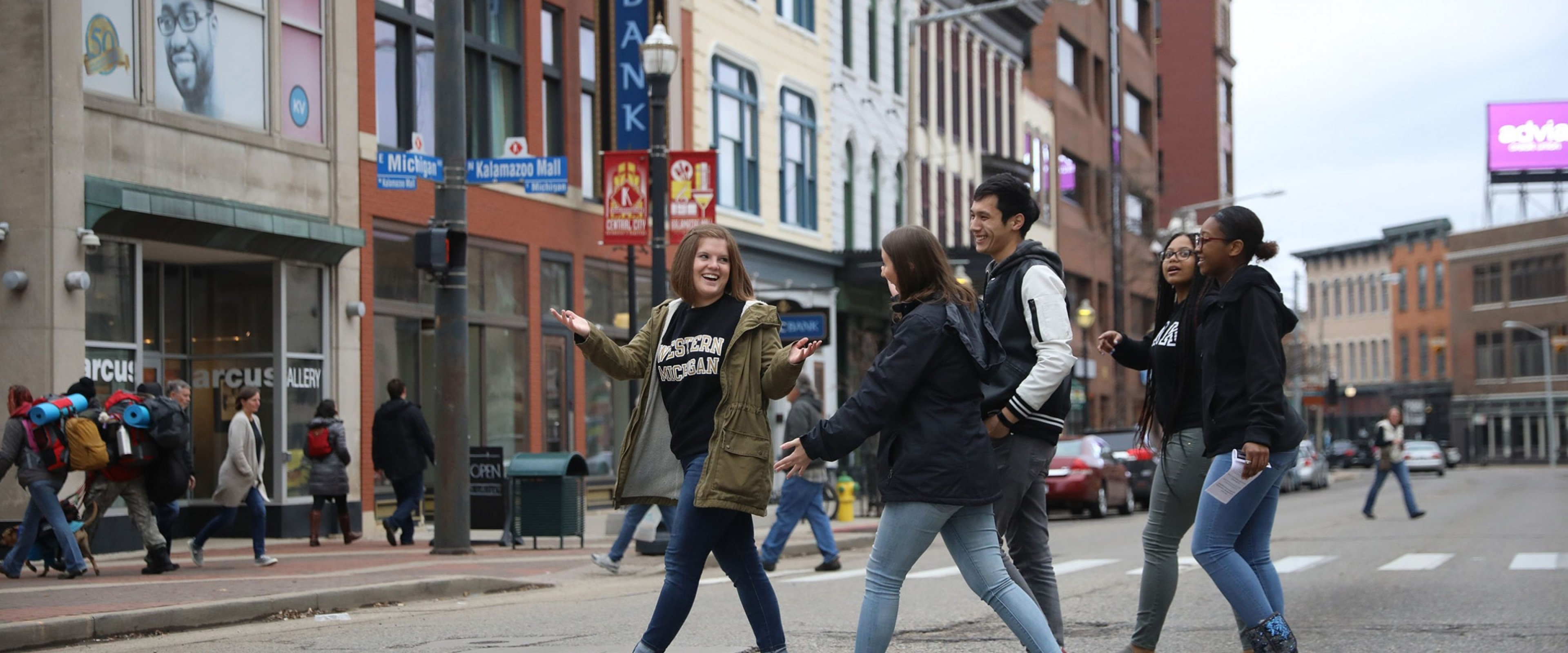 A group of WMU students cross West Michigan Avenue in downtown Kalamazoo