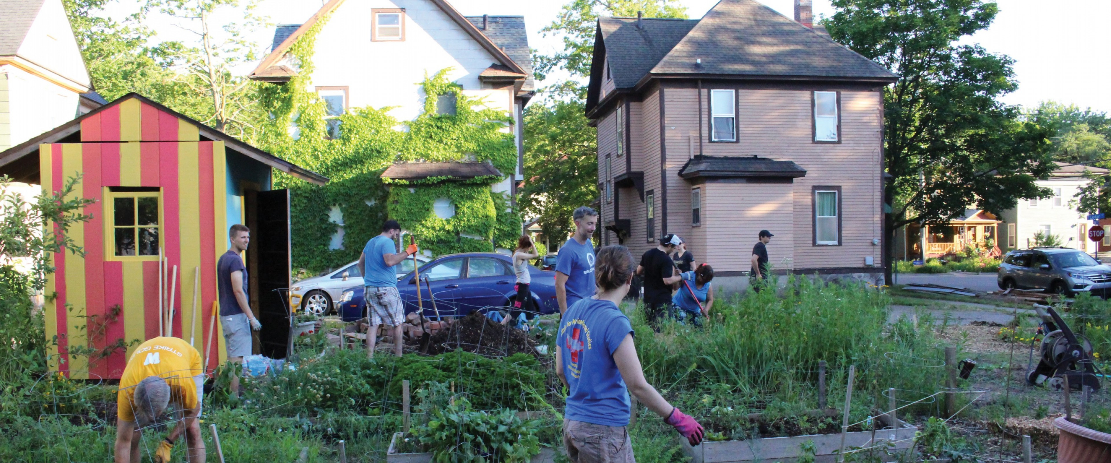 Several people working in a Kalamazoo neighborhood garden