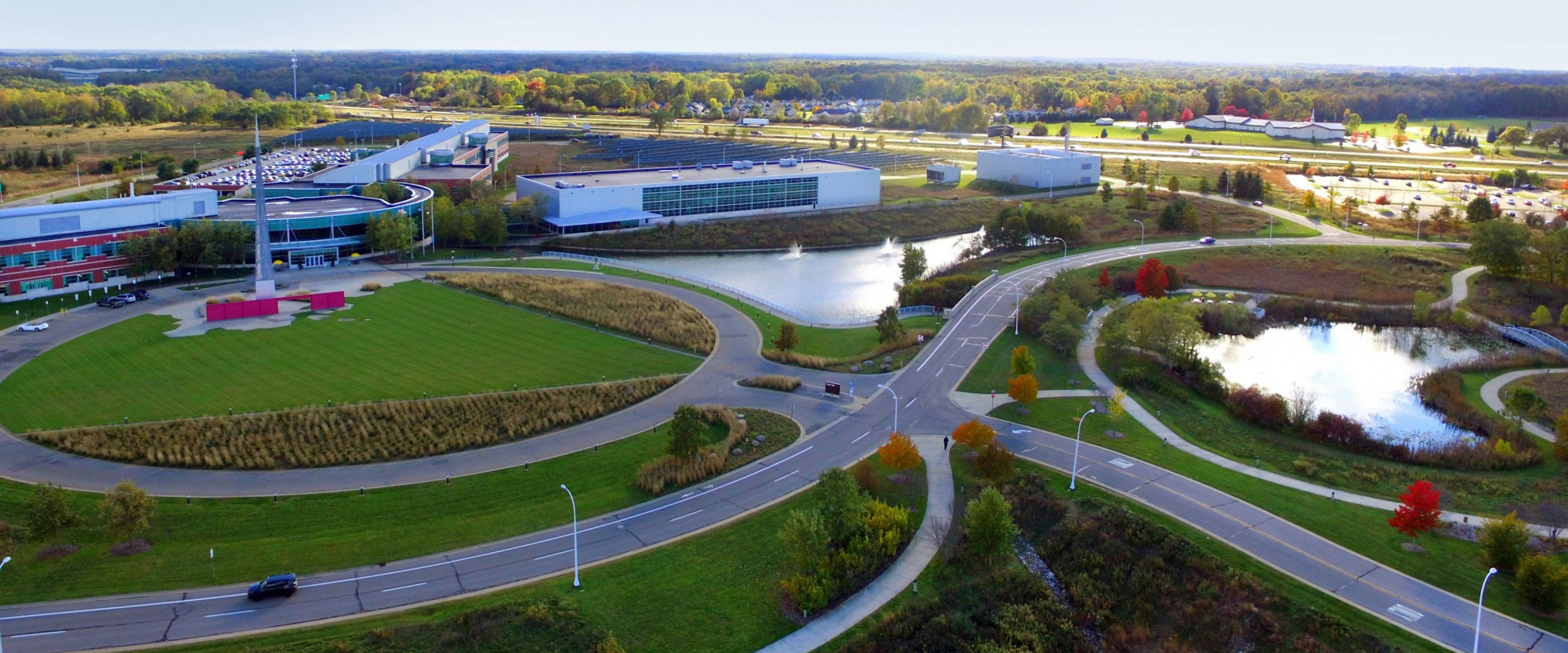 Aerial photo of WMU's Parkview Campus showing the winding roads and ponds that surround the College of Engineering and Applied Sciences