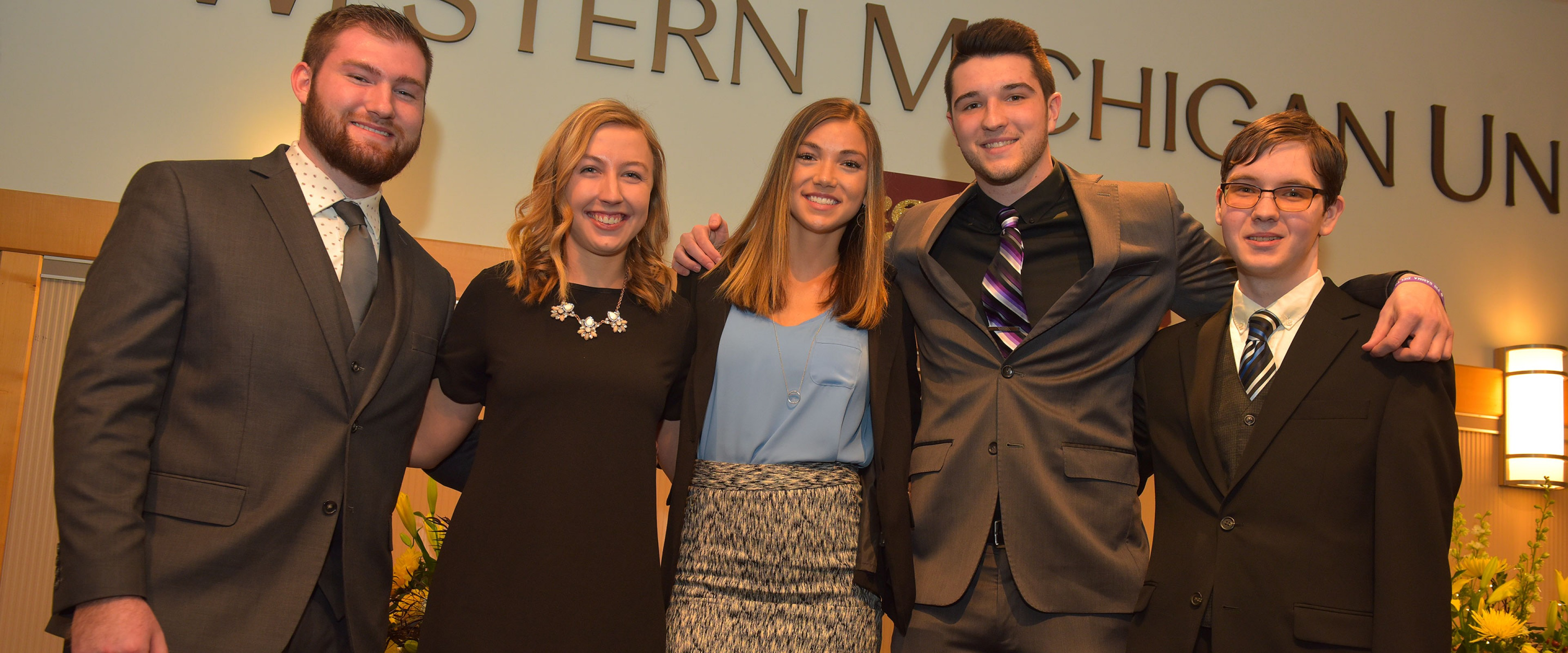 5 WMU students pose together after receiving a group award