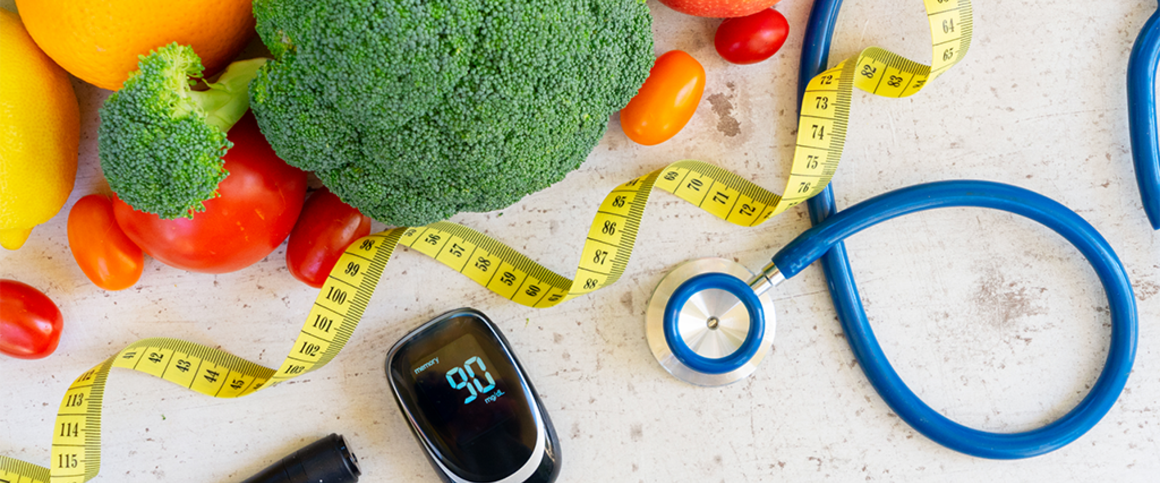 vegetables on a table, diabetes meter, measuring tape and stethoscope