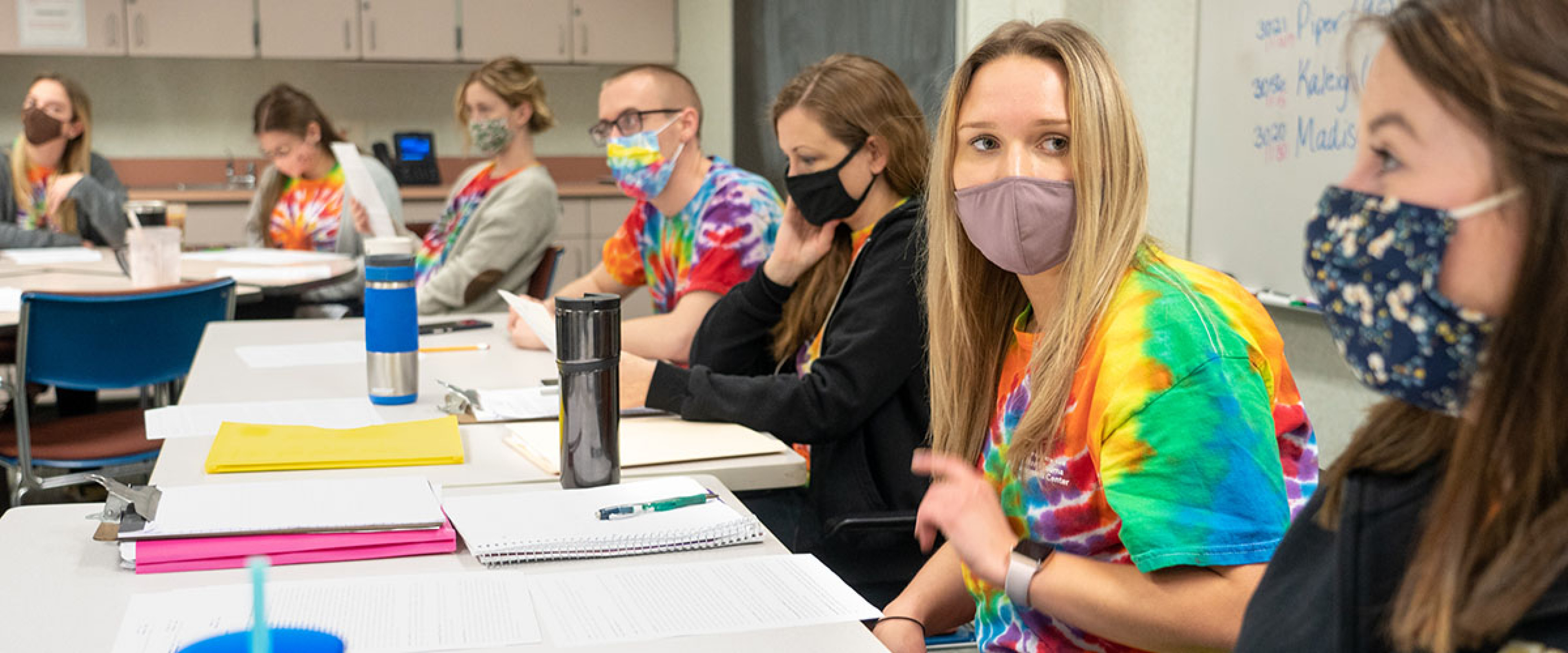masked OT students around a table