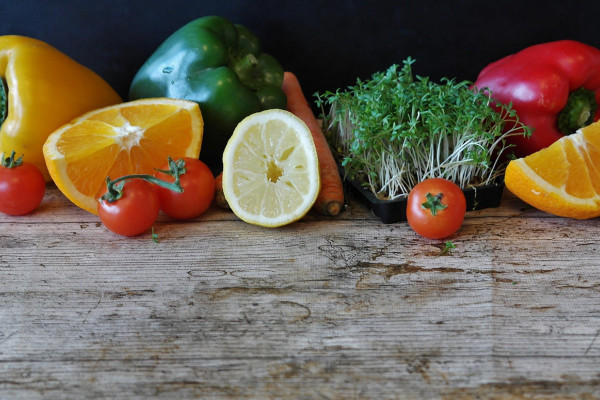 Fruits and vegetables displayed on a wooden counter