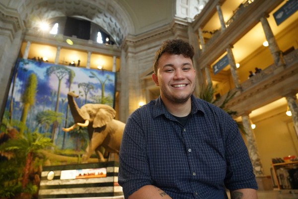 Tre Goodhue sits in the rotunda of the Smithsonian National Museum of Natural History.