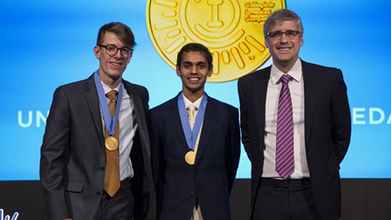 Joseph Barnett and Stephen John with Mo Rocca at the Collegiate Inventors Competition