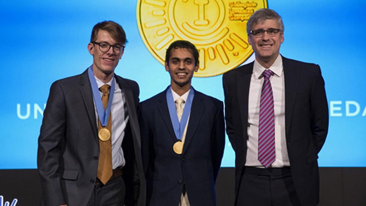 Joseph Barnett and Stephen John with Mo Rocca at the Collegiate Inventors Competition