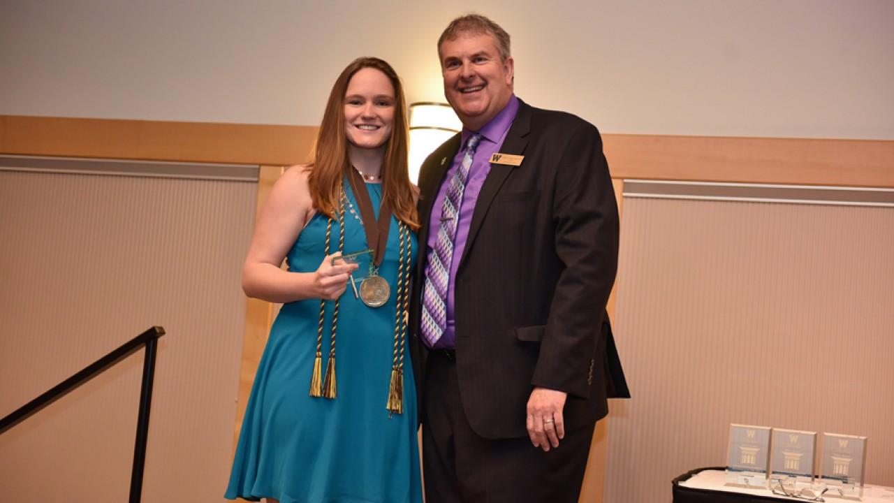Honors student Kelly Brandon receives the pillar award