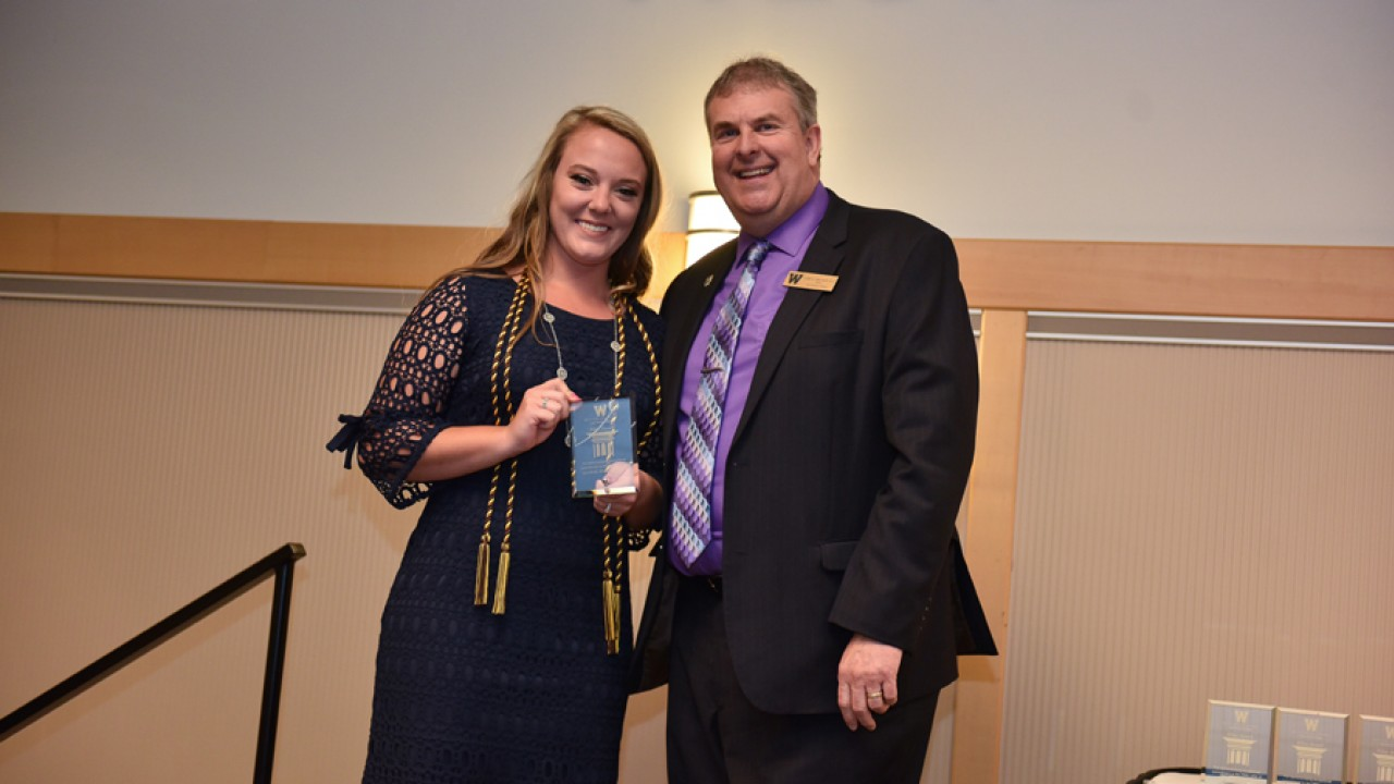 Honors student Erin Caspers receives the pillar award