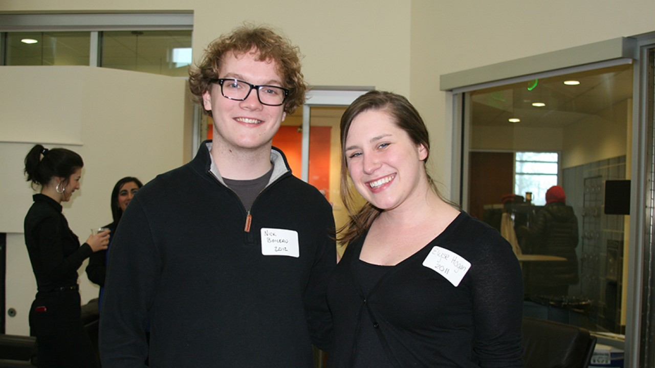 One male and one female Medallion alum attending a reunion in the honors college lounge.
