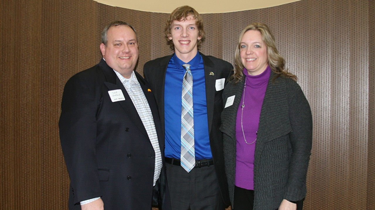 On Medallion alum and his wife, as well as his son who is a current Medallion Scholar attending the reunion in the lounge.