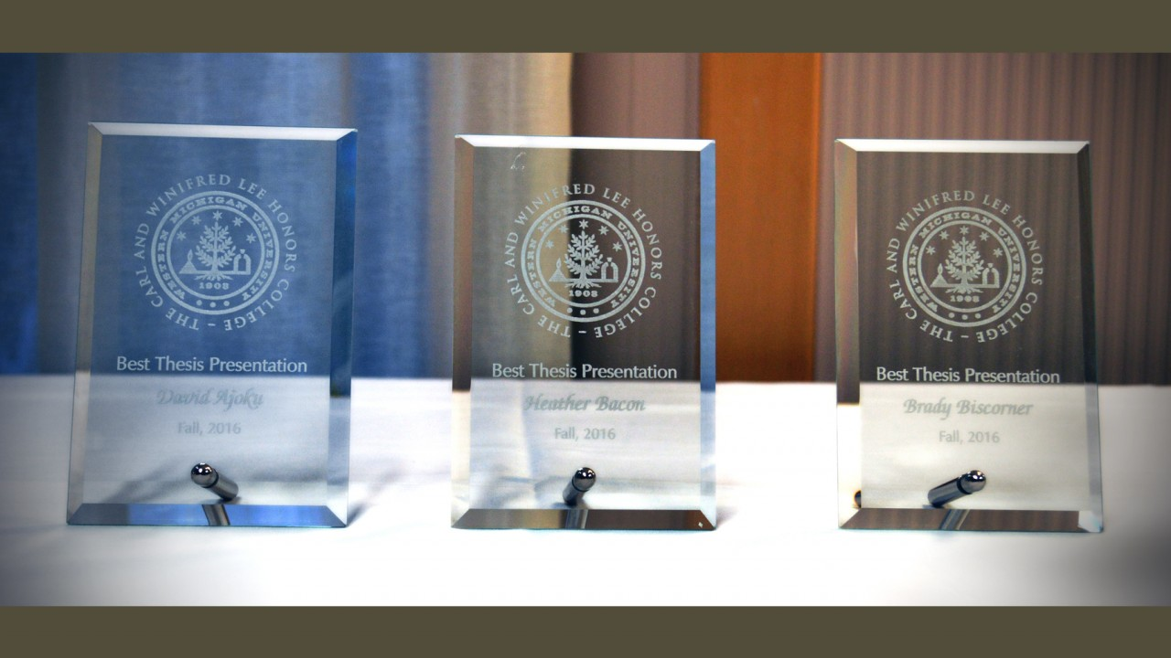 Three glass awards for best thesis presentation.