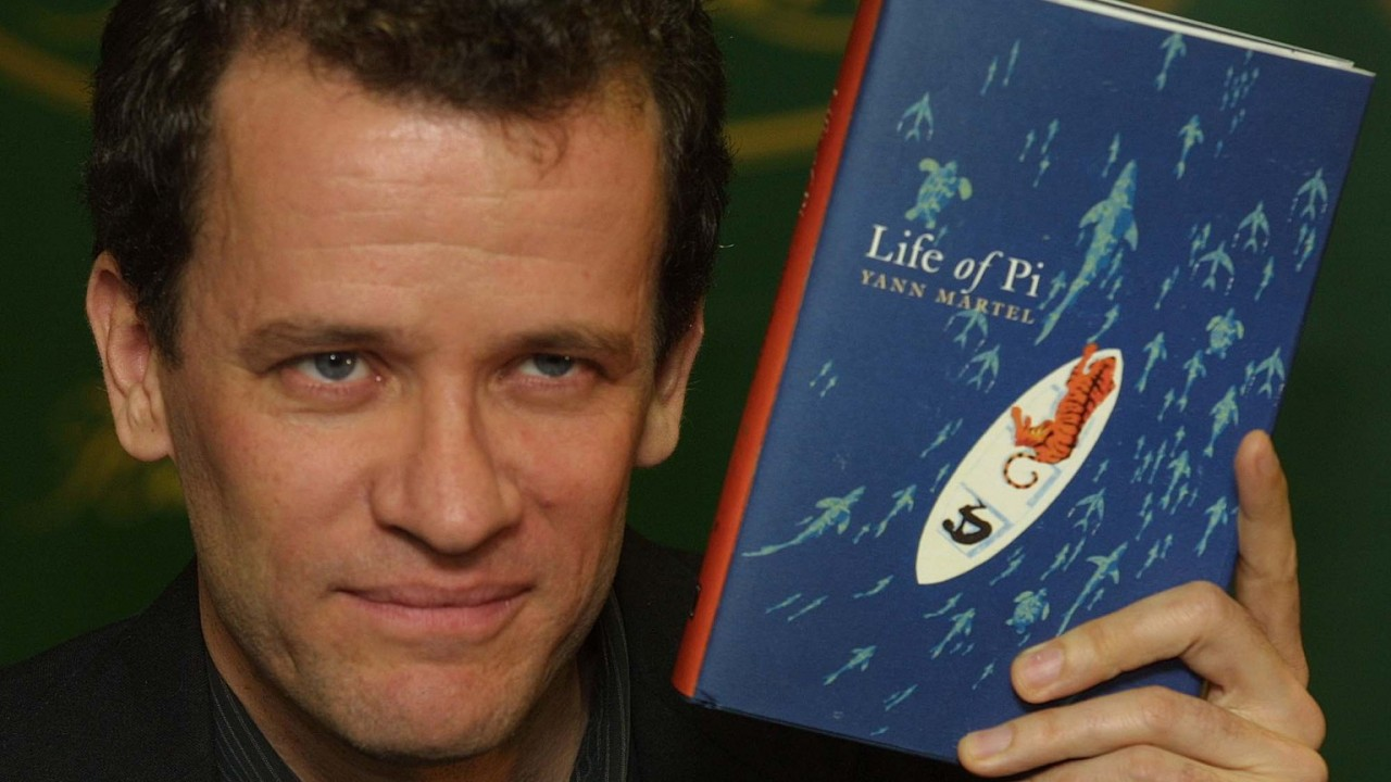 Author Yann Martel holding a copy of Life of Pi
