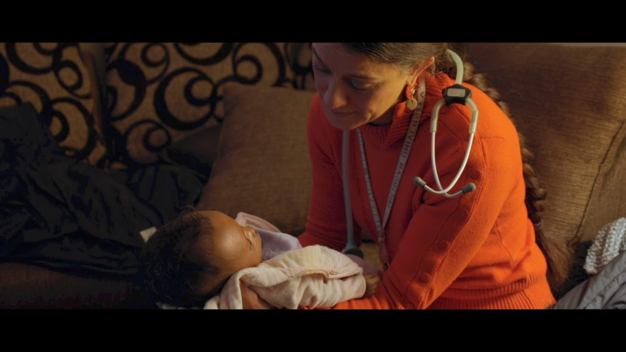 Dr. Nadia Tremonti holds a small baby.