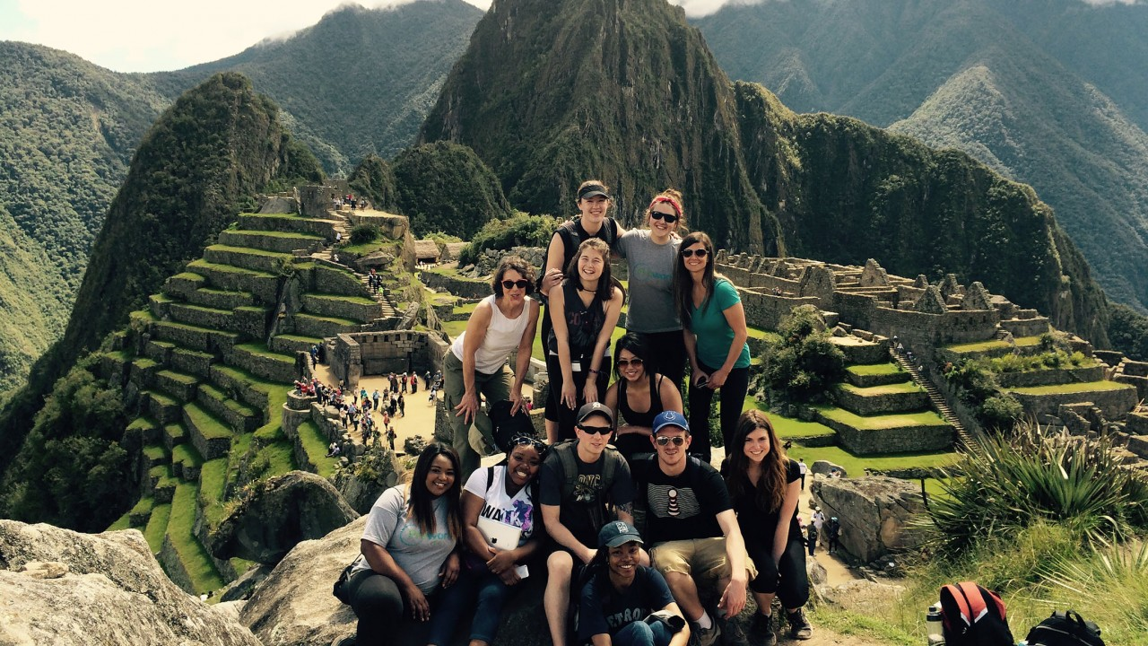 Group of students pose in front of Machu Picchu in Peru