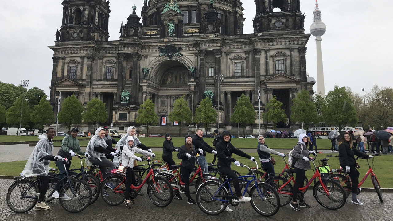Students biking through Germany