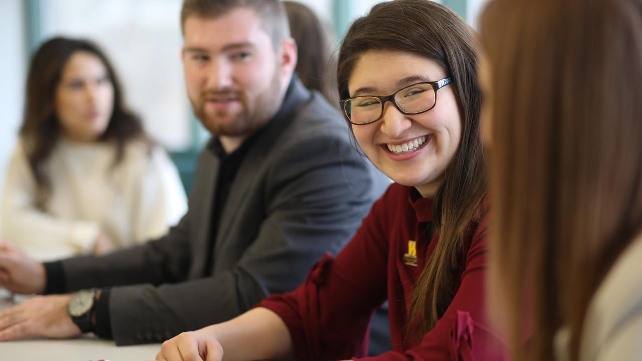 Three students sitting in classroom