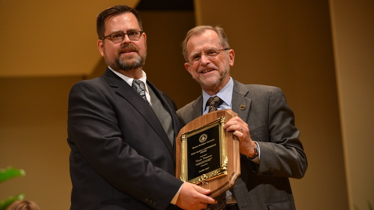 Kevin Knutson receiving the Make a Difference Annual Award from President Dunn