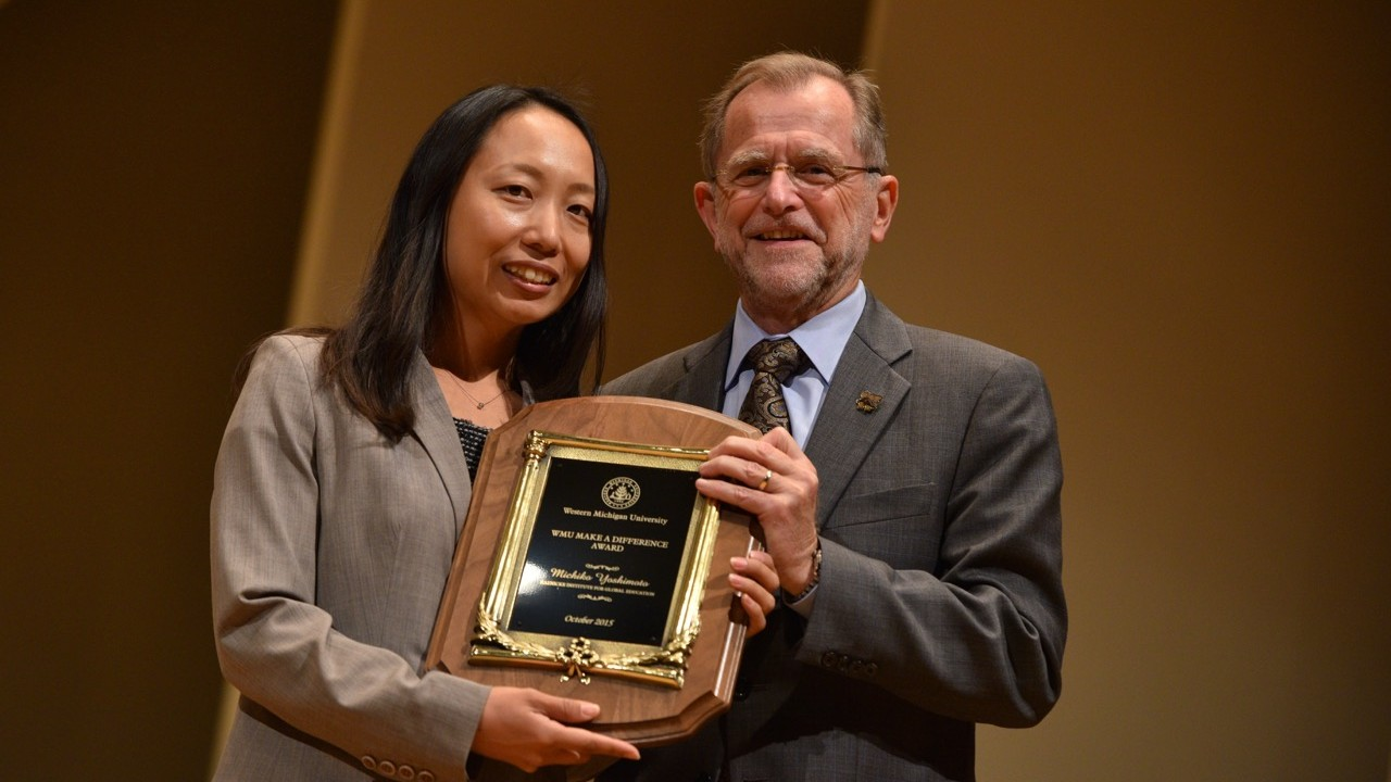 Michiko Yoshimoto receiving the Make a Difference Annual Award from President Dunn