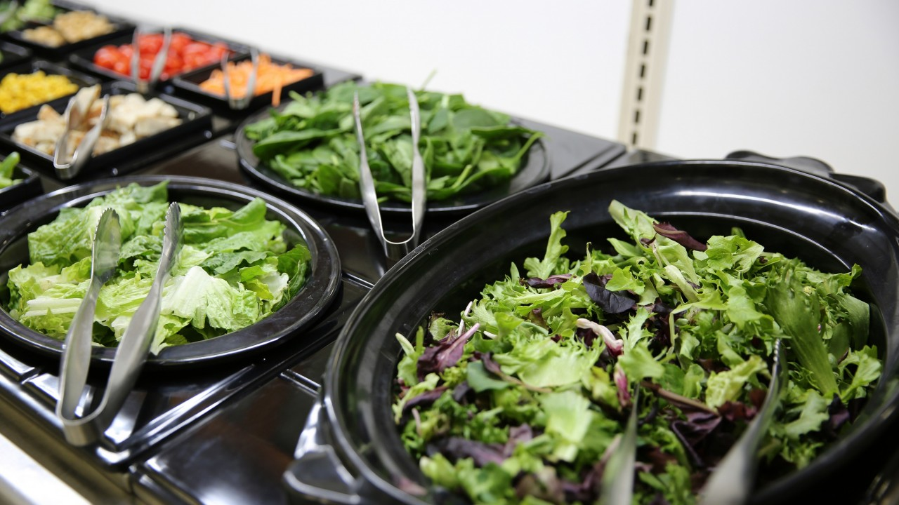 Salad bar featuring fresh greens and lots of vegetables