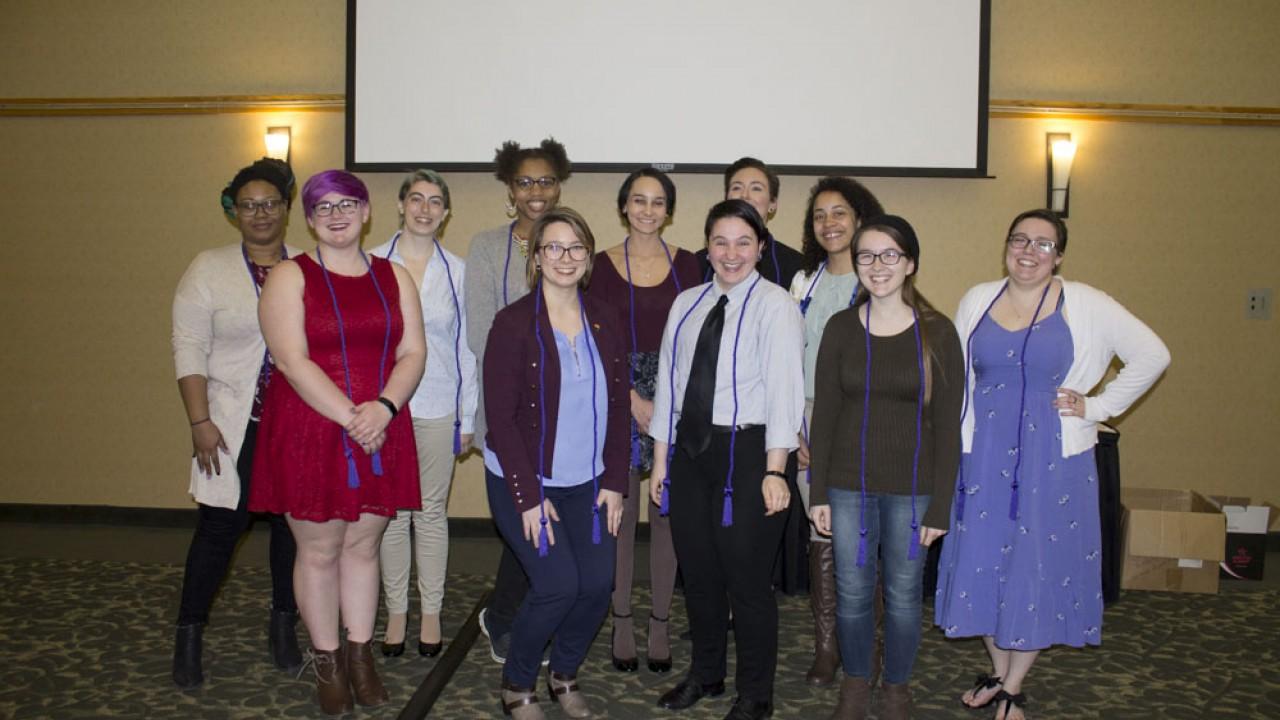 Group of Lavender Graduation graduates 2019 wearing lavender cords.