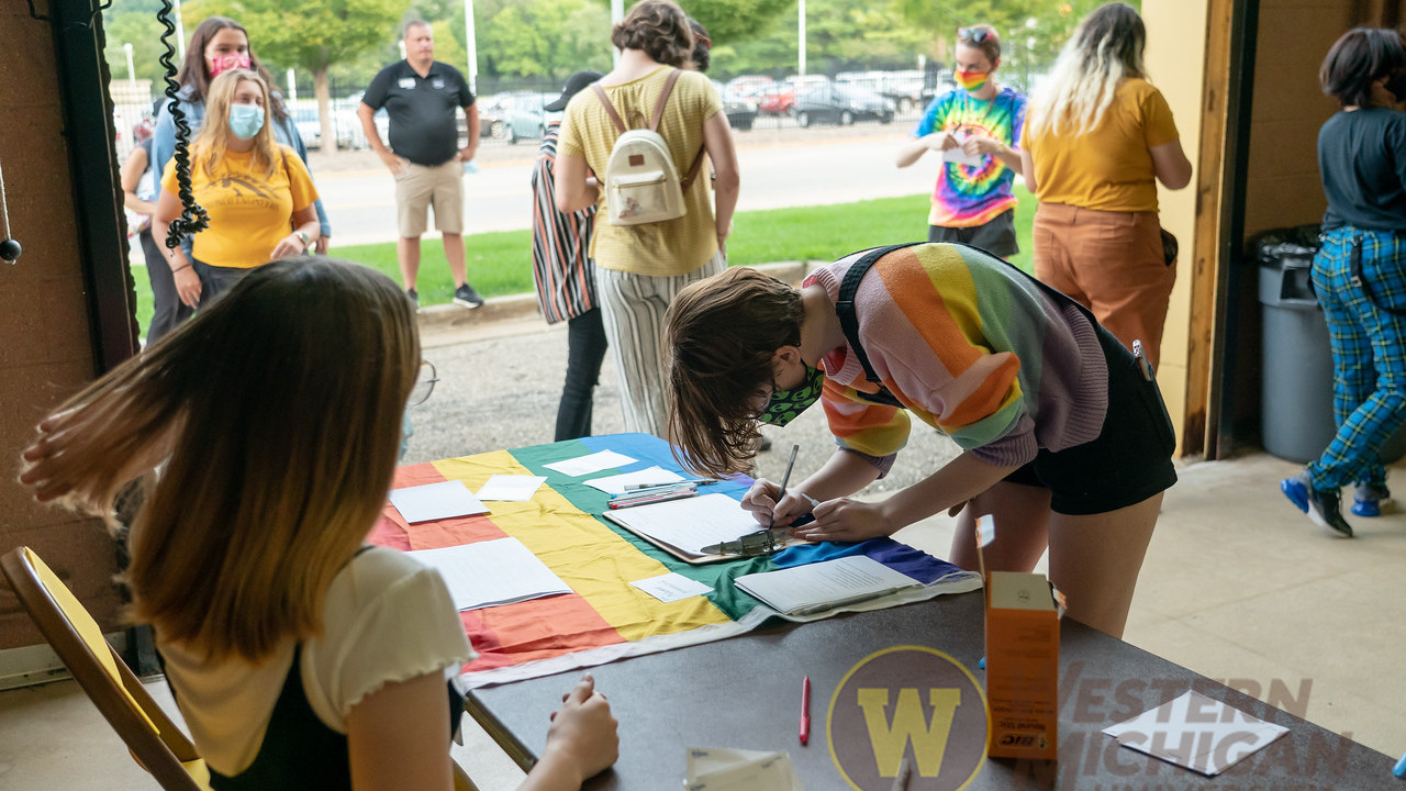 Student signing in at Fall Fab Fest 2021