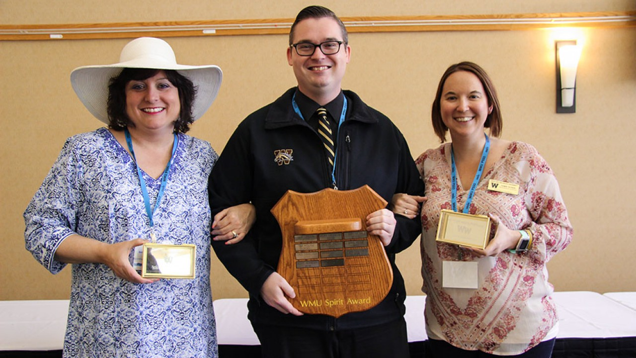 Photo of three recipients of the service and spirit awards