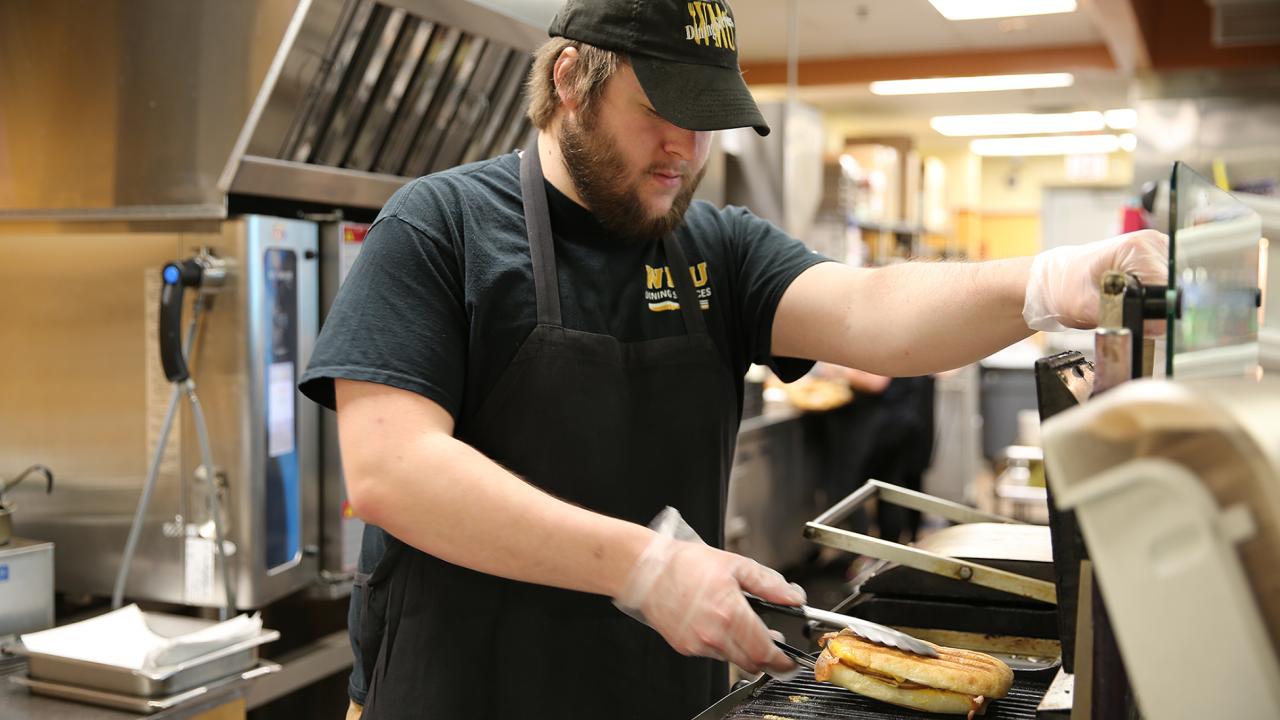 Student making a panini